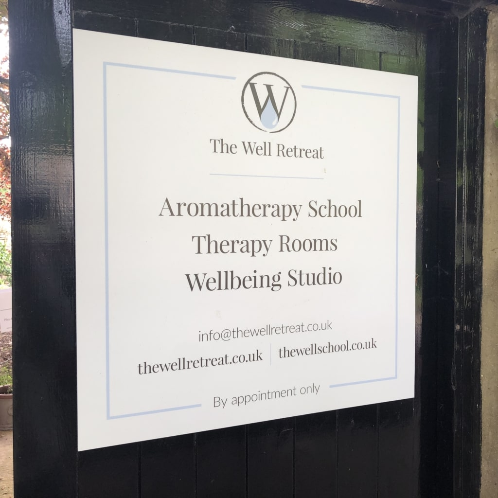 The Well Retreat sign design